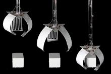white paper actuators in front of black background